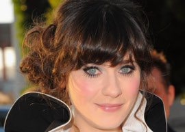 Zoeey Deschanel usando coque lateral
