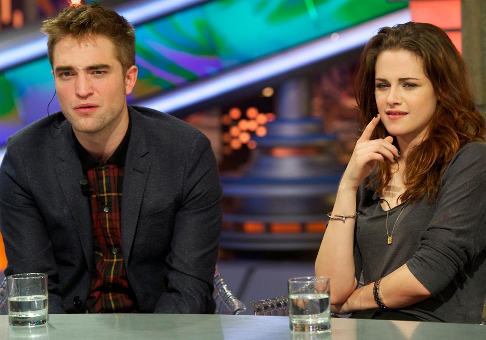 Robert Pattinson e Kristen Stewart com cara de dúvida