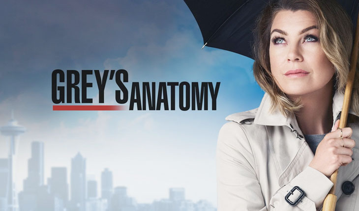 personagem de greys anathomy segurando guarda-chuva