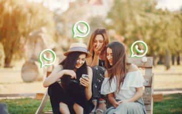 Novo recurso do whatsapp. Na foto, três amigas mexendo no celular
