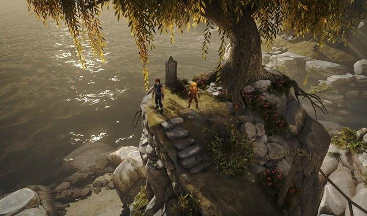 Irmãos do jogo Brother - A Tale of Two Sons na beira de um lago, embaixo de uma árvore